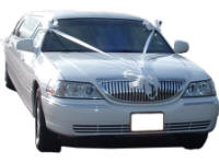 Cars for Stars (Newcastle) - Wedding Limo. White Lincoln stretched wedding limousine with white ribbons